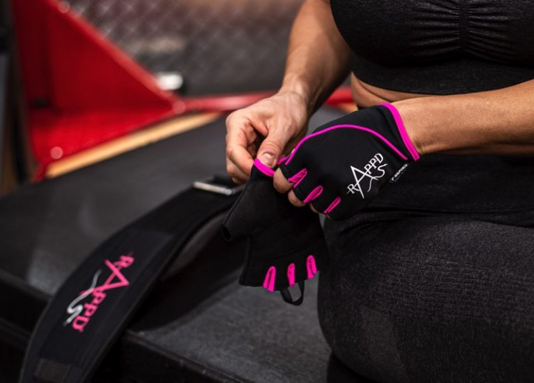 Woman putting on training gloves