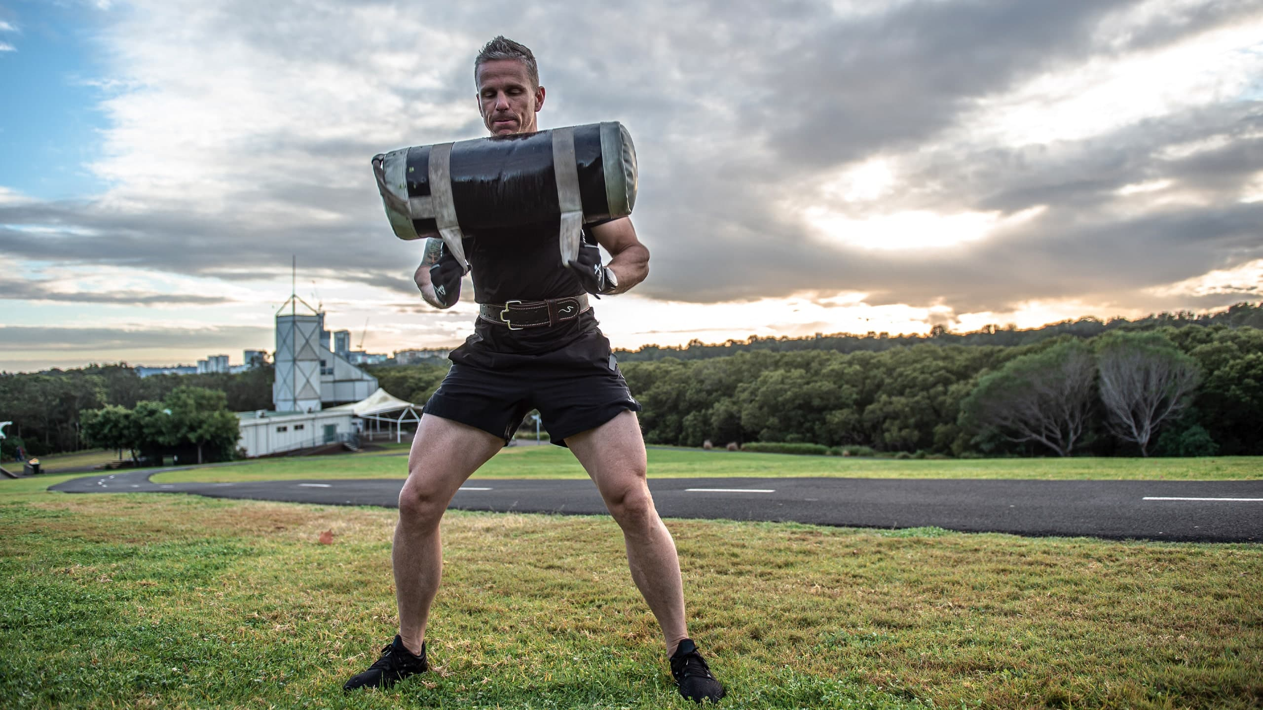 Man training outside using rappd gym accessories