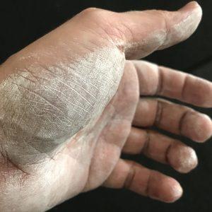 Man's palm with liquid chalk applied