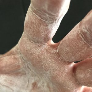 close up of a hand with liquid chalk on it
