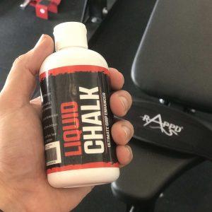 Man holding Rappd Liquid Chalk 250ml bottle